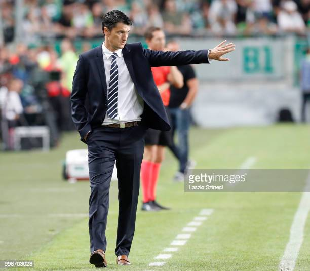 Head coach Vladimir Ivic of Maccabi Tel Aviv FC reacts during the UEFA Europa League First Qualifying Round 1st Leg match between Ferencvarosi TC and...