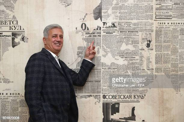 Head Coach Vladimir Petkovic of Switzerland points to Switzerland on the map as he poses for the camera during Day 1 of the 2018 FIFA World Cup...
