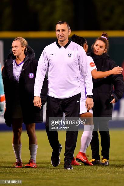 Head coach Vlatko Andonovski walks onto the field after the match against the Seattle Reign FC at Memorial Stadium on April 20 2019 in Seattle...