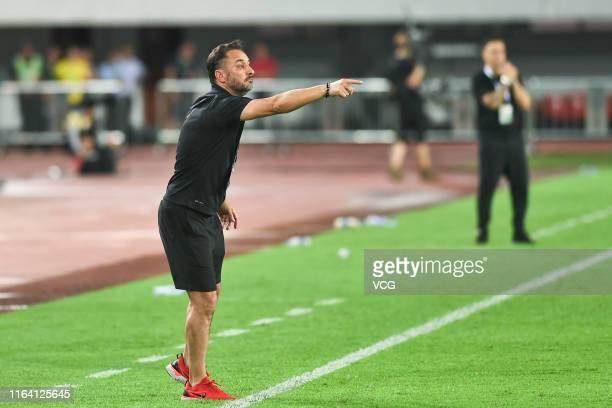 Head coach Vítor Pereira of Shanghai SIPG look on during the 2019 Chinese Football Association Cup quarterfinal match between Guangzhou Evergrande...