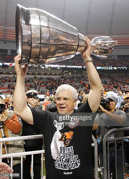 Head coach Wally Buono celebrate with the Grey Cup after the BC Lions beat the Winnipeg Blue Bombers 3423 to win the CFL 99th Grey Cup November 27...