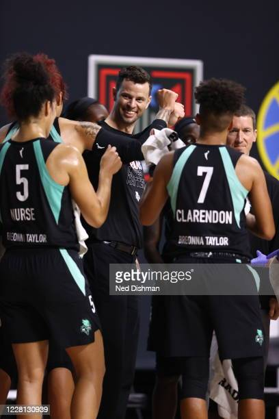 Head coach Walt Hopkins of the New York Liberty smiles during the game against the Chicago Sky on August 20, 2020 at Feld Entertainment Center in...