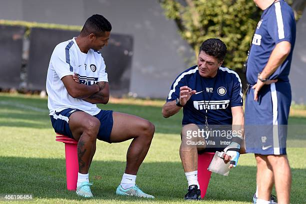 Head coach Walter Mazzarri and Fredy Guarin during an FC Internazionale training session at the club's training ground at Appiano Gentile on...