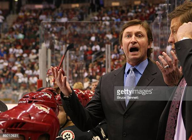 Head Coach Wayne Gretzky of the Phoenix Coyotes manages his team from behind the bench during his game against the St. Louis Blues on February 28,...