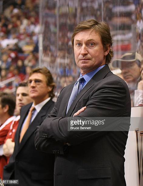 Head Coach Wayne Gretzky of the Phoenix Coyotes manages his team from behind the bench during his game against the St Louis Blues on February 28 2009...