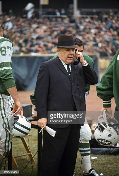 Head coach Weeb Ewbank of the New York Jets looks on while talking on the phone on the sidelines during an AFL football game circa 1969 at Shea...