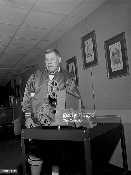 Head coach Weeb Ewbank of the New York Jets poses for a portrait while watching game films during training camp in August 1964 in Peekskill New York