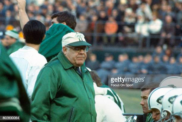 Head coach Weeb Ewbank of the New York Jets talks with his players on the sidelines during an AFL football game circa 1969 at Shea Stadium in the...