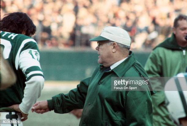 Head coach Weeb Ewbank of the New York Jets talks with quarterback Joe Namath on the sidelines during an AFL football game circa 1969 at Shea Stadium...