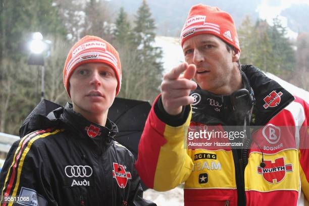 Head coach Werner Schuster of Germany talks to his athlete Pascal Bodmer prior to training round of the FIS Ski Jumping World Cup event during the...