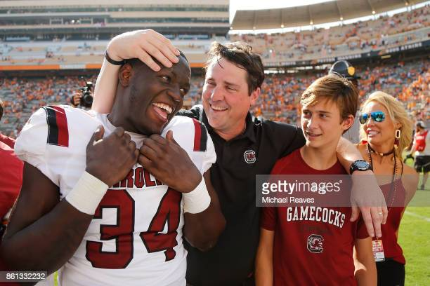 Head coach Will Muschamp of the South Carolina Gamecocks celebrates with his son Whit Muschamp and Mon Denson after the game against the Tennessee...