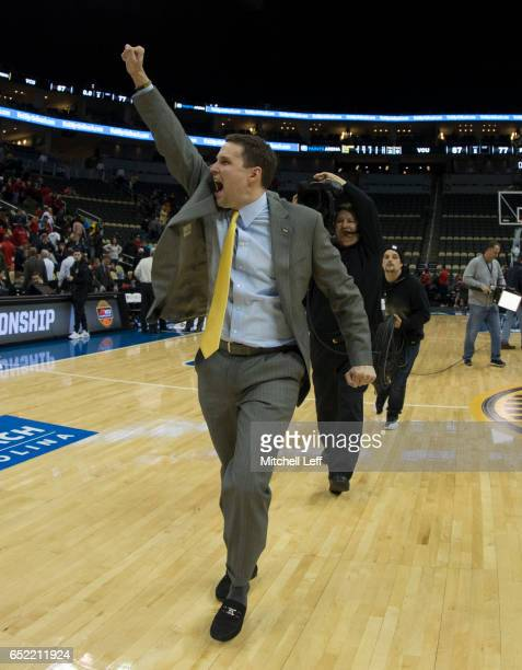 Head coach Will Wade of the Virginia Commonwealth Rams celebrates at the end of the game against the Richmond Spiders in the Semifinals of the men's...
