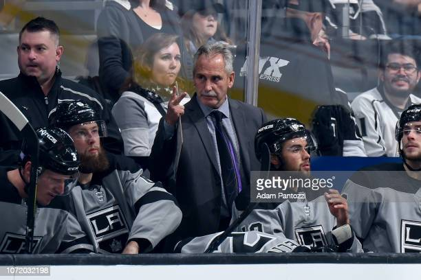 Head coach Willie Desjardins of the Los Angeles Kings gestures while on the bench during the second period of the game against the Vancouver Canucks...