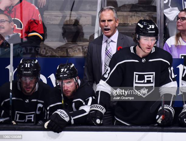 Head coach Willie Desjardins of the Los Angeles Kings shouts on the bench while Anze Kopitar Jeff Carter and Tyler Toffoli of the Los Angeles Kings...