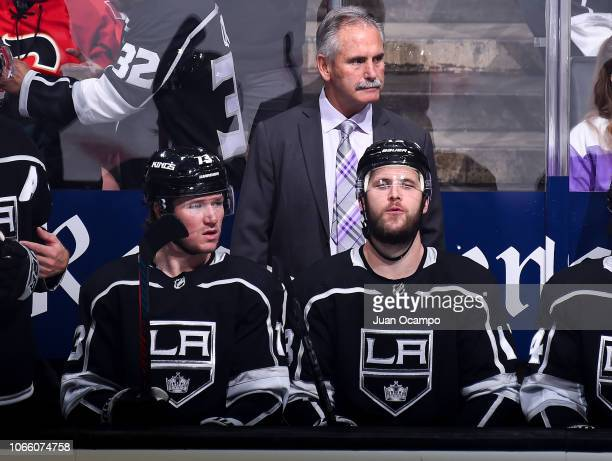 Head coach Willie Desjardins of the Los Angeles Kings watches the game with Tyler Toffoli and Kyle Clifford on the bench during the third period of...