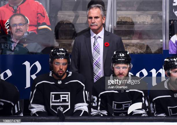 Head coach Willie Desjardins of the Los Angeles Kings watches the game with Alex Iafallo and Kyle Clifford on the bench during the third period of...