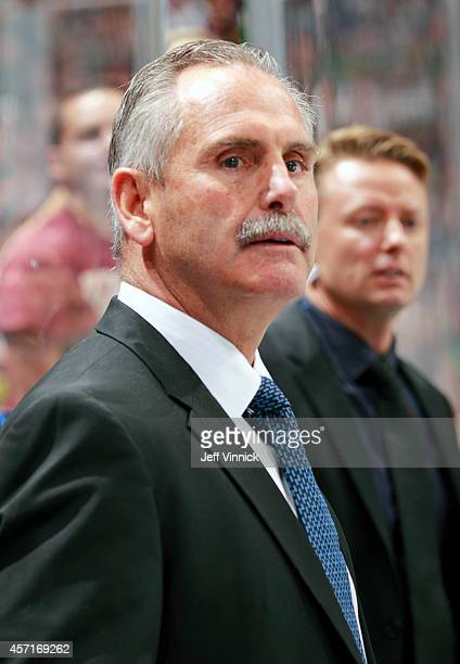 Head coach Willie Desjardins of the Vancouver Canucks looks on from the bench during their NHL game against the Edmonton Oilers at Rogers Arena...