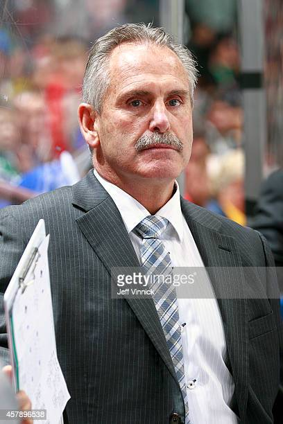 Head coach Willie Desjardins of the Vancouver Canucks looks on from the bench looks on from the bench during their NHL game against theTampa Bay...