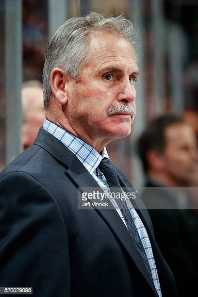Head coach Willie Desjardins of the Vancouver Canucks looks on from the bench during their NHL game against the Los Angeles Kings at Rogers Arena...