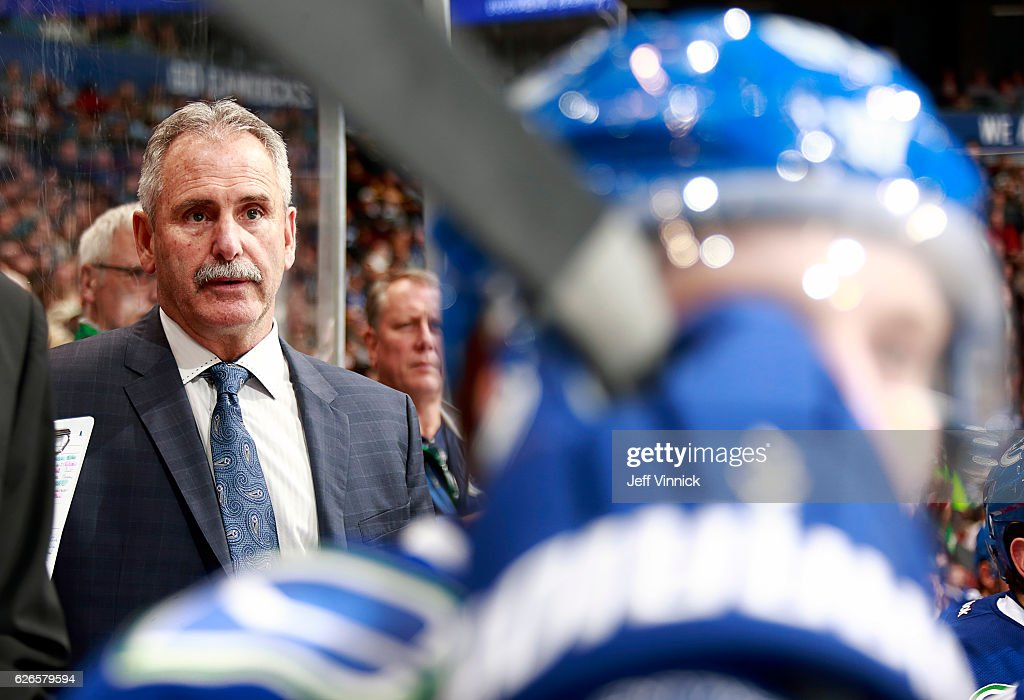 Head coach Willie Desjardins of the Vancouver Canucks looks on from the bench during their NHL game against the Minnesota Wild at Rogers Arena November 29, 2016 in Vancouver, British Columbia, Canada. Vancouver won 5-4.