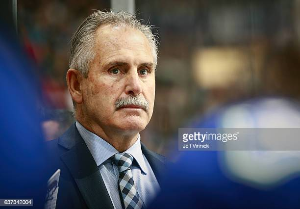 Head coach Willie Desjardins of the Vancouver Canucks looks on from the bench during their NHL game against the Winnipeg Jets at Rogers Arena...