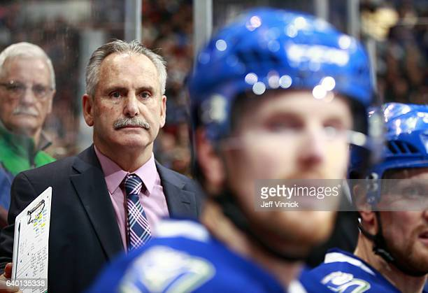 Head coach Willie Desjardins of the Vancouver Canucks looks on from the bench during their NHL game against the Florida Panthers at Rogers Arena...