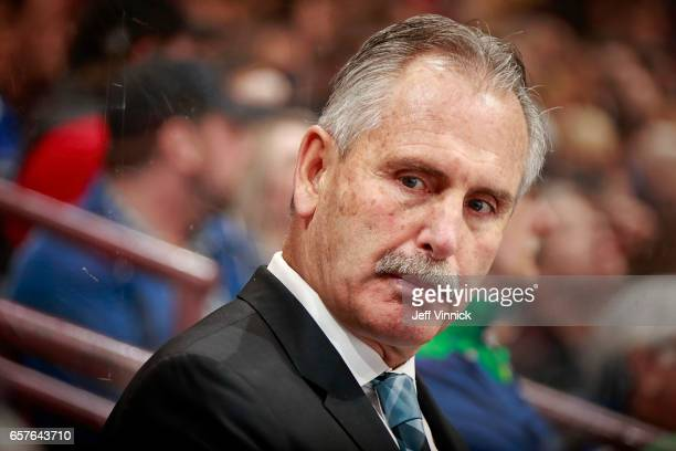 Head coach Willie Desjardins of the Vancouver Canucks looks on from the bench during their NHL game against the Detroit Red Wings at Rogers Arena...