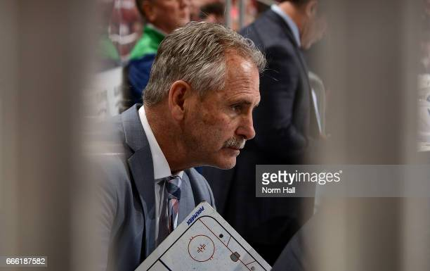 Head coach Willie Desjardins of the Vancouver Canucks looks on from the bench against the Arizona Coyotes at Gila River Arena on April 6 2017 in...