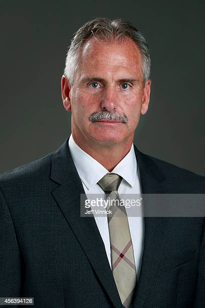 Head coach Willie Desjardins of the Vancouver Canucks poses for his official headshot for the 20142015 season on September 18 2014 at the Rogers...