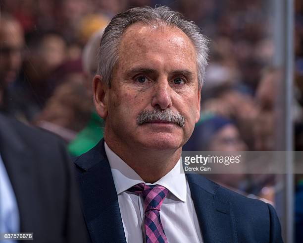 Head coach Willie Desjardins of the Vancouver Canucks watches the play during their NHL game against the Anaheim Ducks at Rogers Arena December 30...