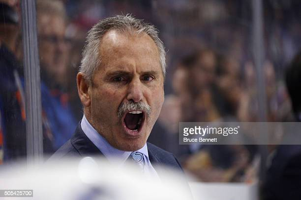 Head coach Willie Desjardins of the Vancouver Canucks yells out instructions during the third period against the New York Islanders at the Barclays...