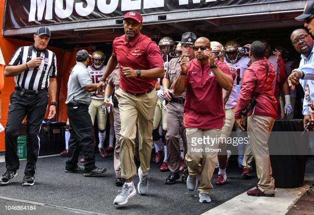 Head coach Willie Taggart and the Florida State Seminoles take the field before the game against the Miami Hurricanes at Hard Rock Stadium on October...