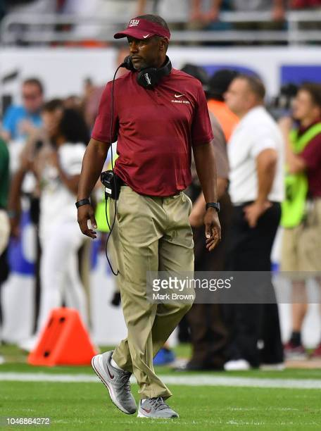 Head coach Willie Taggart of the Florida State Seminoles coaching in the second half against the Miami Hurricanes at Hard Rock Stadium on October 6...