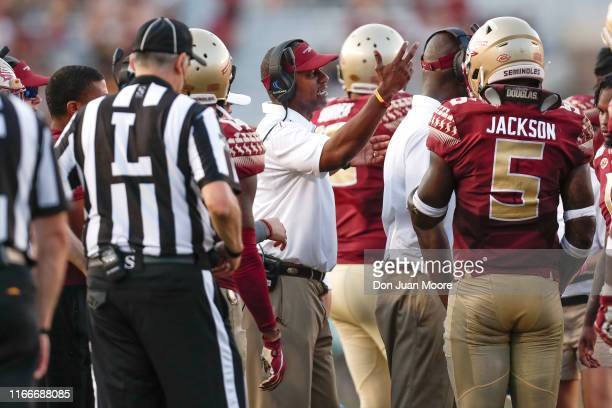 Head Coach Willie Taggart of the Florida State Seminoles take with his team during the game against the Louisiana Monroe Warhawks at Doak Campbell...