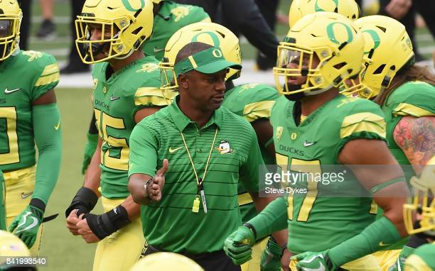 Head coach Willie Taggart of the Oregon Ducks greets his palyers before the game against the Southern Utah Thunderbirds at Autzen Stadium on...