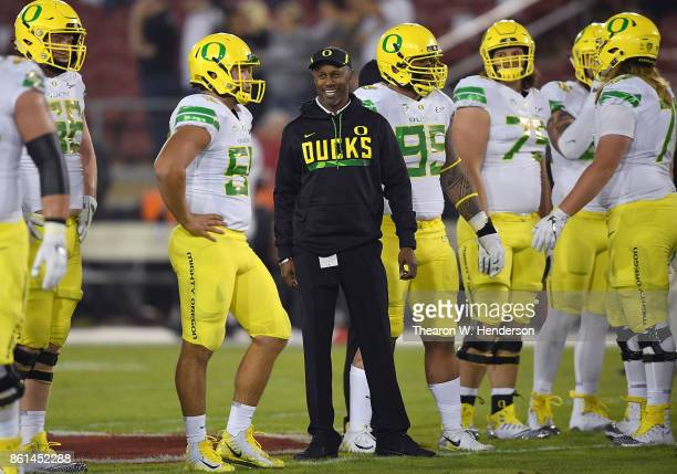 Head coach Willie Taggart of the Oregon Ducks looks on while his team warms up during pregame warm ups prior to playing the Stanford Cardinal at...