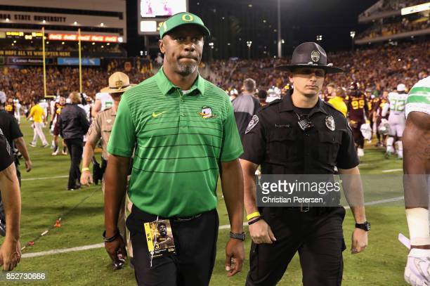 Head coach Willie Taggart of the Oregon Ducks walks off the field after being defeated by the Arizona State Sun Devils in the college football game...