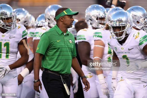 Head coach Willie Taggart of the Oregon Ducks watches warm ups to the college football game against the Arizona State Sun Devils at Sun Devil Stadium...