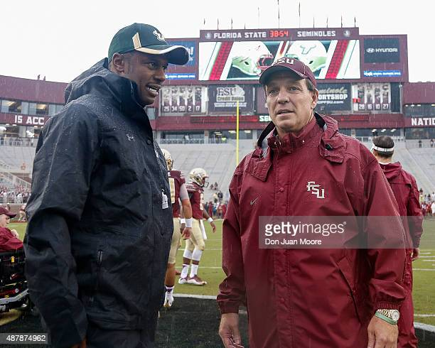 Head Coach Willie Taggart of the South Florida Bulls talk with Head Coach Jimbo Fisher of the Florida State Seminoles before the game at Doak...