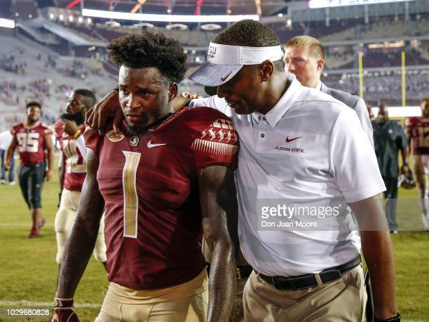 Head Coach Willie Taggart talk with Cornerback Levonta Taylor of the Florida State Seminoles after the game against the Samford Bulldogs at Doak...