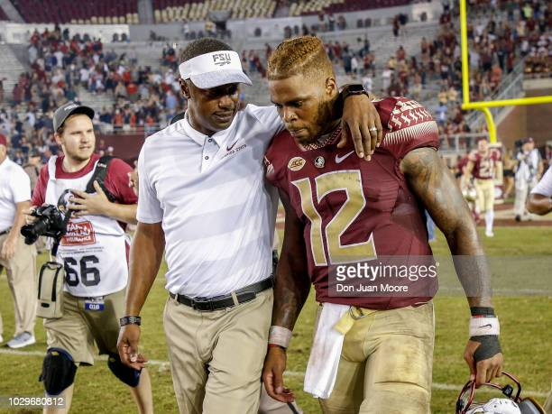 Head Coach Willie Taggart talk with his Quarterback Deondre Francois of the Florida State Seminoles after the game against the Samford Bulldogs at...