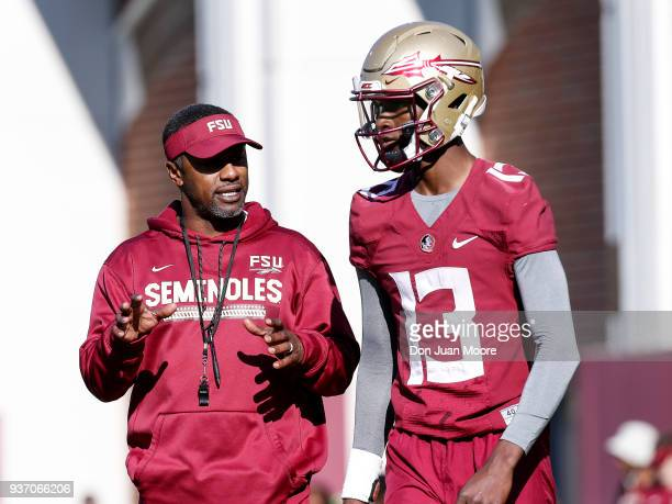 Head Coach Willie Taggart talks with Quarterback James Blackman of the Florida State Seminoles during Spring Football Practice at the Albert J Dunlap...