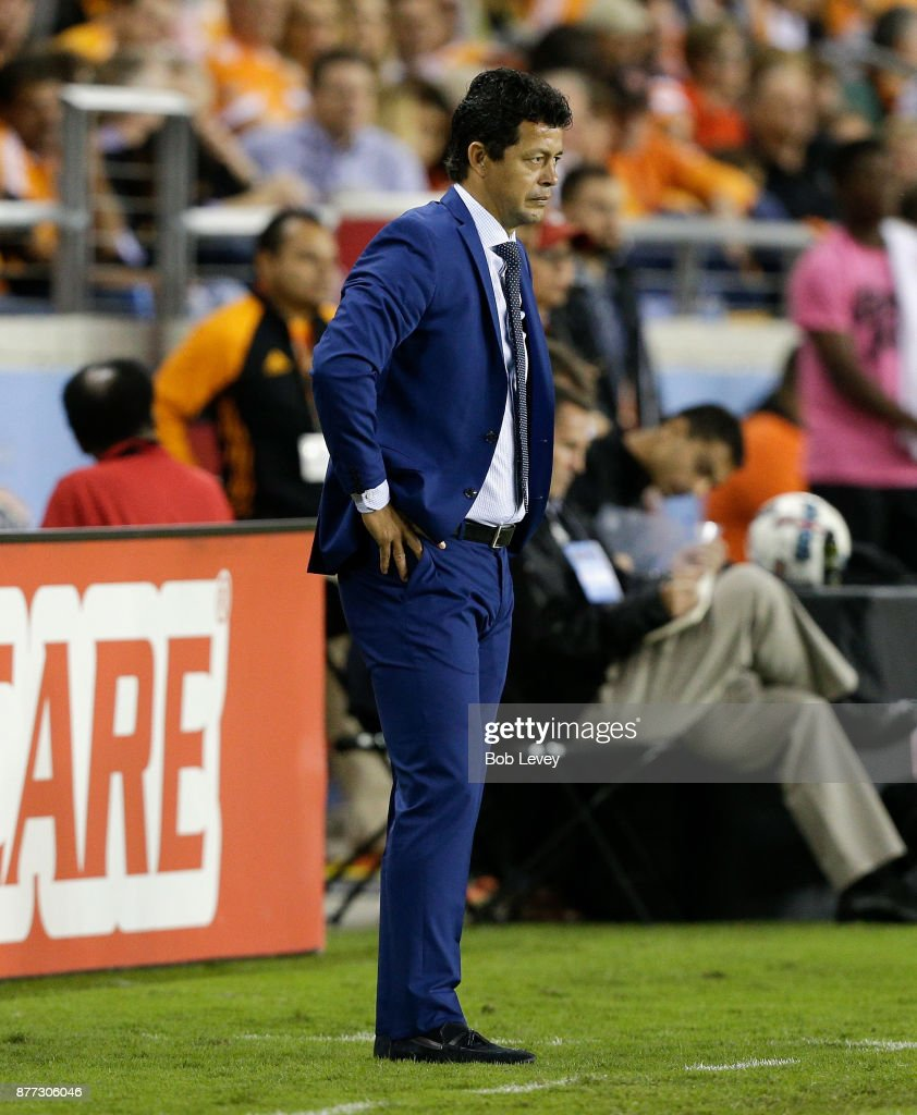Head coach Wilmer Cabrera of the Houston Dynamo looks on from the bench area against the Seattle Sounders at BBVA Compass Stadium on November 21, 2017 in Houston, Texas.