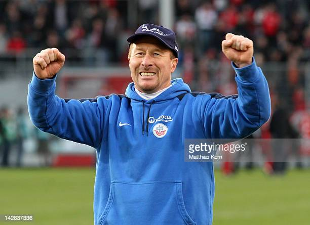 Head coach Wolfgang Wolf of Rostock jubilates after winning the Second Bundesliga match between FC Energie Cottbus and FC Hansa Rostock at Stadion...