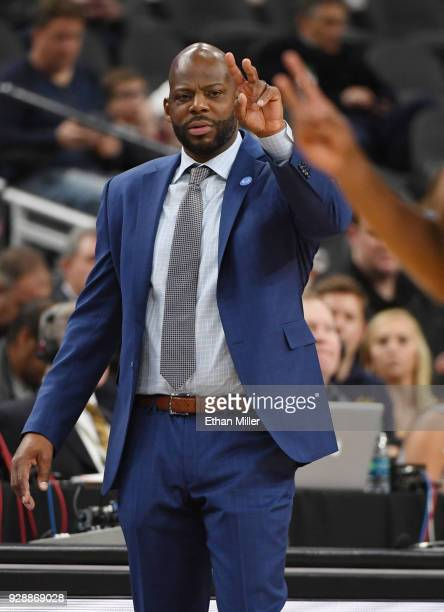 Head coach Wyking Jones of the California Golden Bears signals his players during a firstround game of the Pac12 basketball tournament against the...