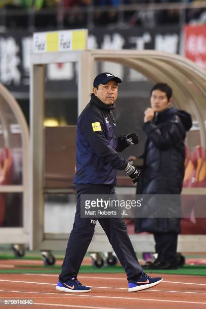 Head coach Yahiro Kazama of Nagoya Grampus celebrates his side's third goal during the JLeague J1 Promotion PlayOff semi final match between Nagoya...
