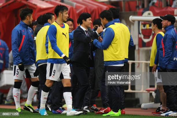 Head coach Yoon Jung Hwan of Cerezo Osaka celebrates his side's 10 victory with his players after the JLeague J1 match between Kashima Antlers and...