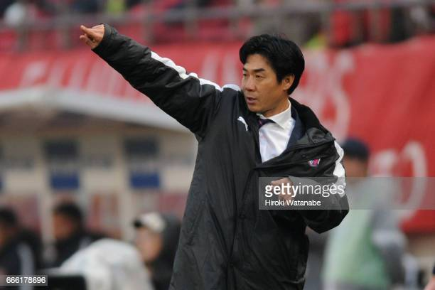 Head coach Yoon Jung Hwan of Cerezo Osaka gestures during the JLeague J1 match between Kashima Antlers and Cerezo Osaka at Kashima Soccer Stadium on...