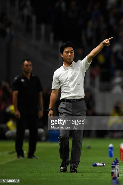Head coach Yoon Jung Hwan of Cerezo Osaka gestures in action during the JLeague J1 match between Gamba Osaka and Cerezo Osaka at Suita City Football...