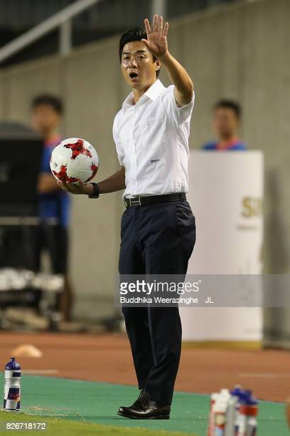 Head coach Yoon Jung Hwan of Cerezo Osaka holds the ball during the JLeague J1 match between Cerezo Osaka and Consadole Sapporo at Kincho Stadium on...